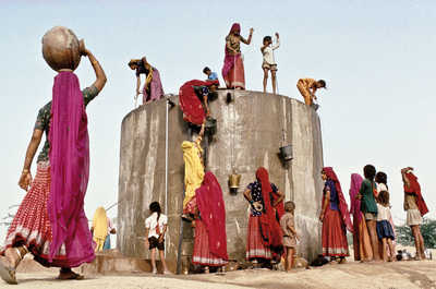 collecting water, Rajasthan by Christopher Pillitz